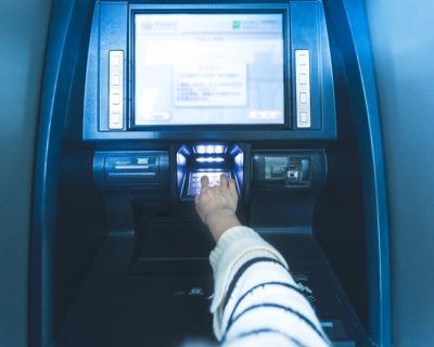 Woman using cash machine-ATM,close up view