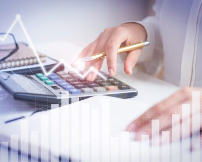 Accountant calculating profit with financial analysis graphs